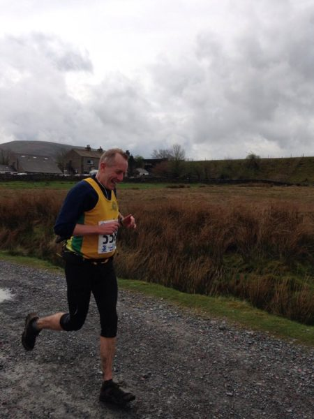 Andy Buck running at Ribblehead, Three Peaks race.