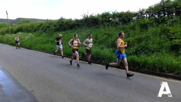 John Rawlinson, Matthew Zawadzki and Jeni Pitkin on the final stretch of the Edale Fell Race.
