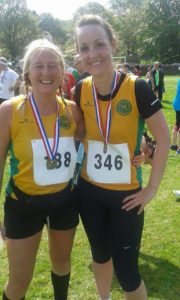 Dawn and Emma with their medals after completing the Holymoorside 10k.