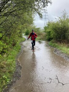 Dave running through a massive puddle