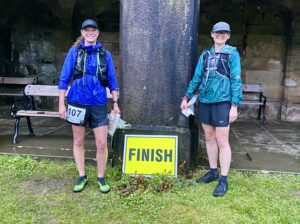 Jennie and Alison by the finish sign