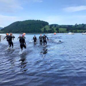 Triathletes entering the lake