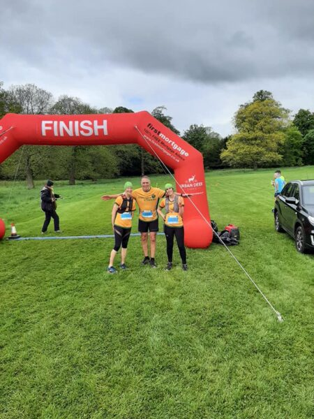 Three Steel City Striders by the finish line